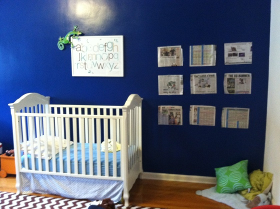 """this also gives a glimpse of the """"reading corner"""" mock up (the pillows are extremely temporary) and the unmade bed pre-crib-skirt making"""