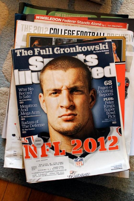 "the ""Tuvia"" magazines i.e. Sports Illustrated, ESPN, Esquire (I secretly love that last one) pile"