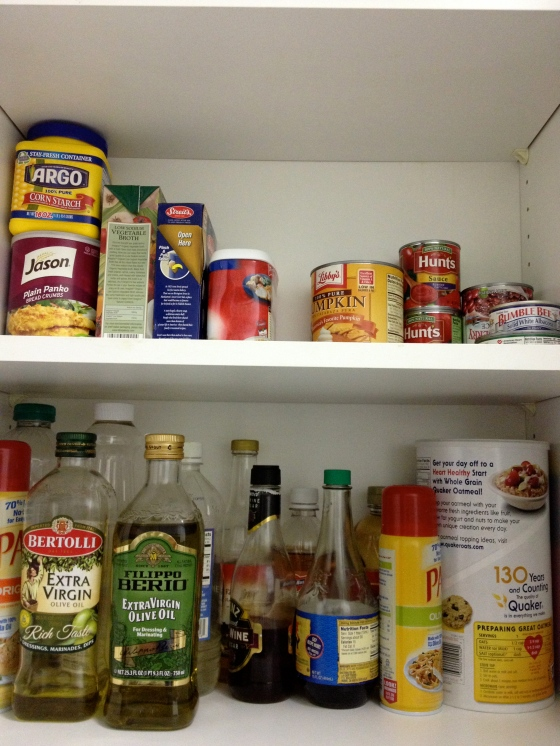 The bottom shelf has the cooking/baking ingredients that we use on a more regular basis and the top shelf has canned goods and things we use less often. Woah, we need to go grocery shopping