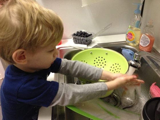 Aiden helping by playing with water in the sink. A total lifesaver, that one.